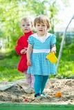Two children playing  in sandbox Royalty Free Stock Photos