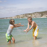 Two children playing in the sea Royalty Free Stock Images