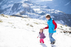Two children playing in snow in mountains Royalty Free Stock Photos