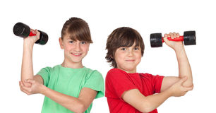 Two children playing sports with weights. Isolated on white background royalty free stock image