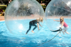 Two children playing in super ball in swimming pool Royalty Free Stock Photography