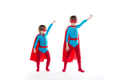 Two children playing in a superhero . Stock Images
