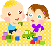 Two children playing with toys Stock Photo