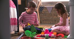 Two Children Playing With Toys In Bedroom Together stock video footage