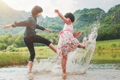 two children playing water stock photo