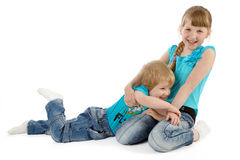 Two children playing on white royalty free stock photography