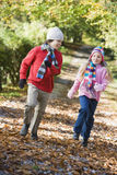 Two children playing in woodland Royalty Free Stock Image