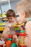 Two children in playroom Royalty Free Stock Images