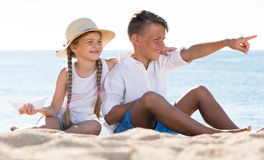 Two children pointing beach Royalty Free Stock Image