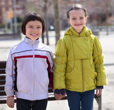 Two children posing outdoors in the spring Stock Images