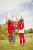 Two children pretending to be superhero. In the park Royalty Free Stock Photography