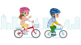 Two children riding Bicycle, Helmet, Cityscape background Stock Image