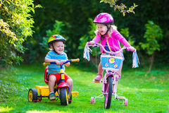 Two Children Riding Bikes Royalty Free Stock Photo