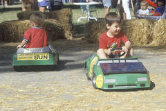 Two children riding solar powered minature cars, Willits, CA Royalty Free Stock Photography