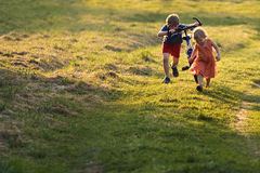 Two children running. In the meadow Stock Photo