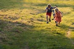 Two children running Stock Photo
