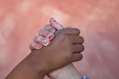 Two children´s hands of differents races together royalty free stock photo
