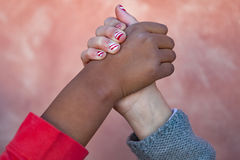 Two children´s hands of differents races together stock photo