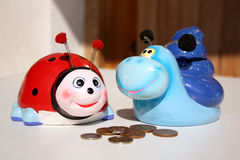 Two children's money boxes. In the shape of animals stock photos