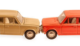 Two children's toy car models collided bumpers. Isolated on white background Stock Photo