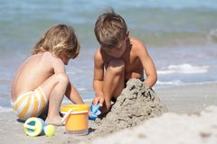 Two children on sand beach. Two children playing on sand beach Stock Image
