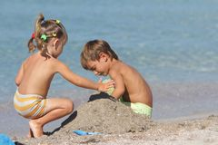 Two children on sand beach. Outdoor portrait of two children playing on sand beach Royalty Free Stock Photos