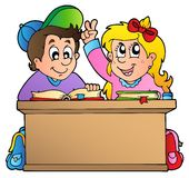 Two children at school desk Royalty Free Stock Photos