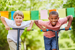 Two children with scooters stand with ambition Stock Photos