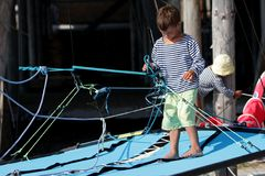 Two children on sea catamaran / yacht Royalty Free Stock Photos