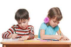 Two children write at the desk Royalty Free Stock Photography
