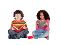 Two Children Sitting On The Floor Reading Stock Images