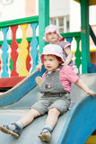 Two children on slide Stock Photo