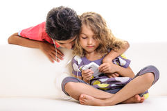 Two children smart phone music Stock Photo
