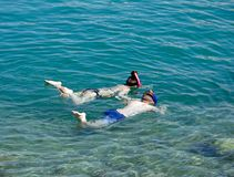Two children snorkelling, Sissi. royalty free stock photos