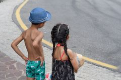 Two children standing on roadside. stock photography