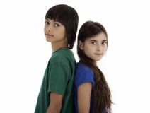 Two children standing back to back Stock Photo