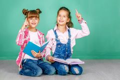 Two children study a school lecture. The concept of childhood, l Stock Photography