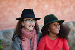 Two children with stylish hats Royalty Free Stock Photo