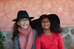 Two children with stylish hats Royalty Free Stock Images