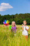 Two children in summer field playing Stock Photo