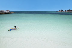 Two children swimming on beach. Portrait of two asian children playing and swimming together on the beach Stock Photo