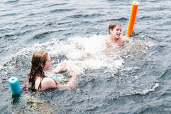 Two children swimming Royalty Free Stock Photos