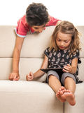 Two children with tablet Stock Photos