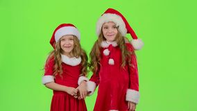 Two children are talking about the celebration of the new year. Green screen. Two children in New Year`s costumes are talking about the celebration of the new stock video footage