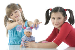 Two children with their favorite dolls Stock Photography