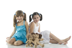 Two children with their favorite dolls stock photos