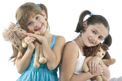 Two children with their favorite dolls Royalty Free Stock Photos
