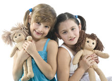 Two children with their favorite dolls Royalty Free Stock Image
