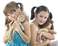 Two children with their favorite dolls Royalty Free Stock Photography