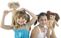 Two children with their favorite dolls Royalty Free Stock Images